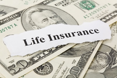 image of money with life insurance sign on top