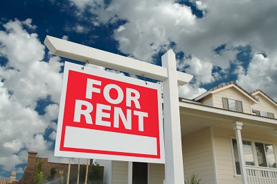 image of house with for rent sign in front
