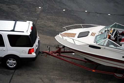 SUV Hauling Boat on Trailer